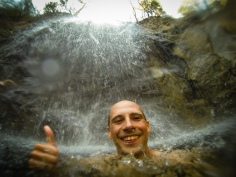 Swimming under a waterfall